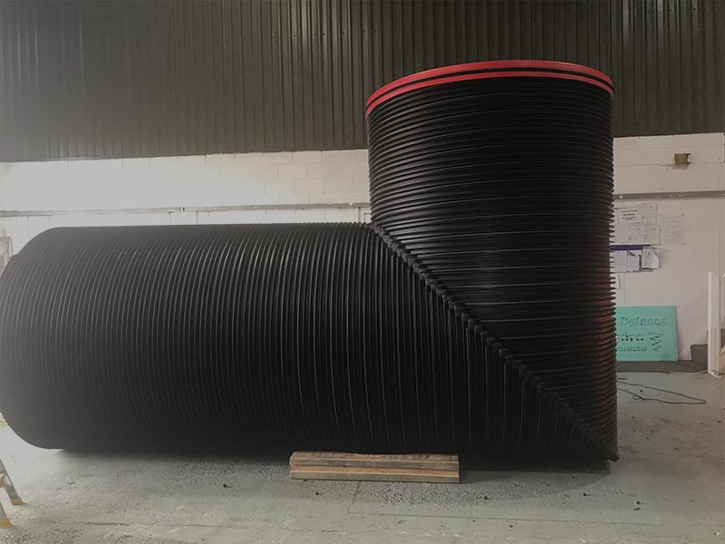 HFS Plastic work showcasing a HDPE length of pipe being made in the shape of an egg