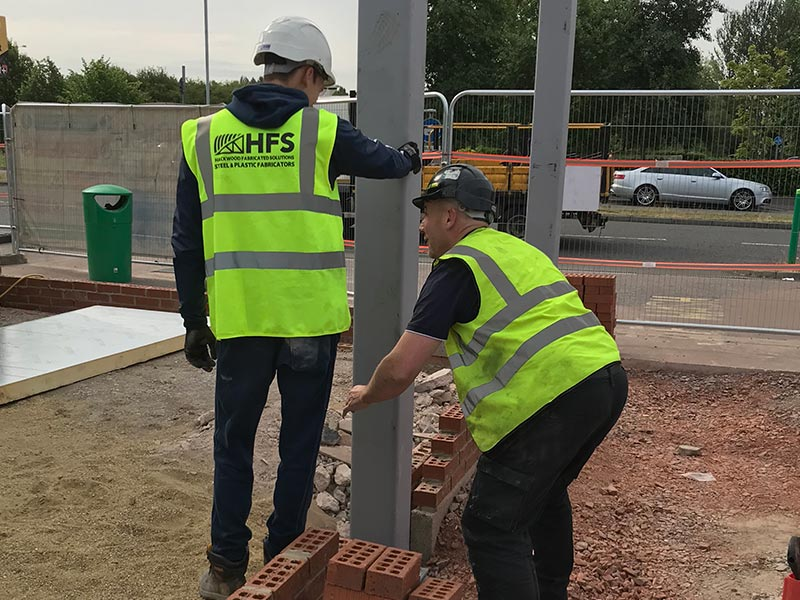 HFS members of staff carrying out an onsite installation which required structual steelwork to be erected for taunton dean services